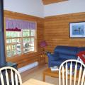 Unsere Blockhütte am See -- Wohnraum